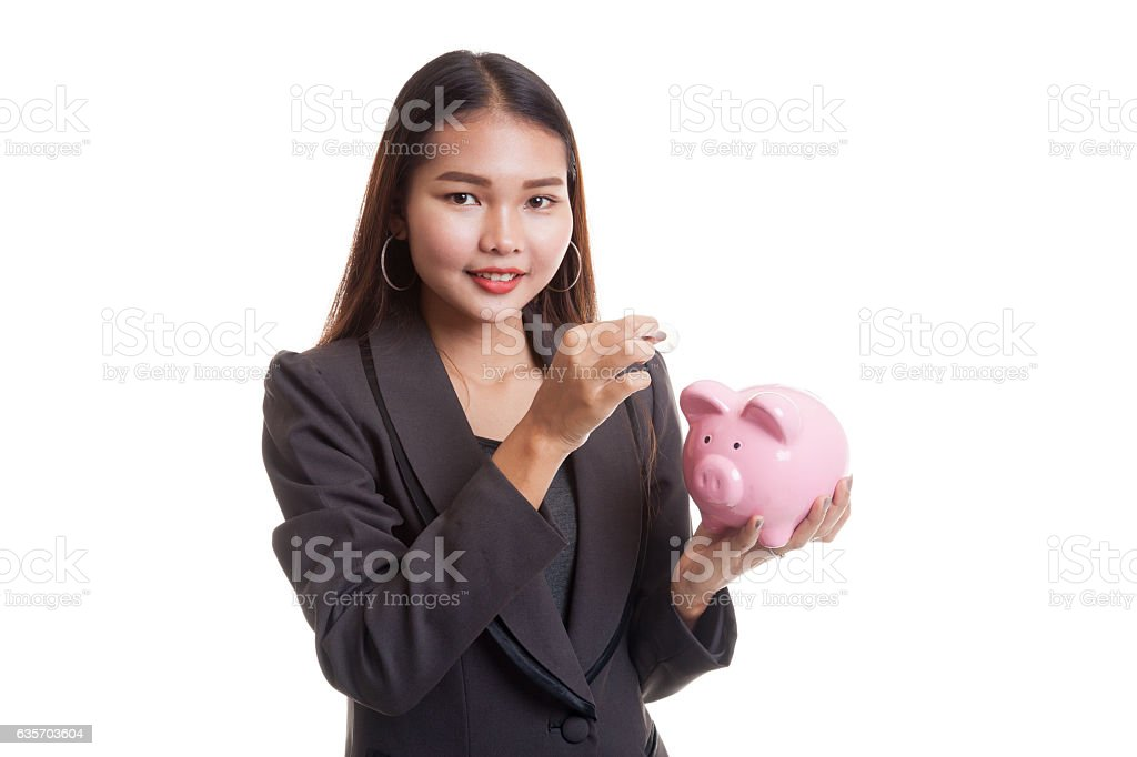 Asian business woman with coin and pig coin bank. royalty-free stock photo