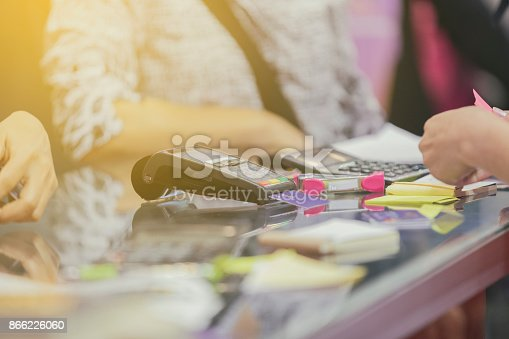 914593772istockphoto Asian Business women hand using credit card swiping machine for payment in cafeteria and supermarket 866226060