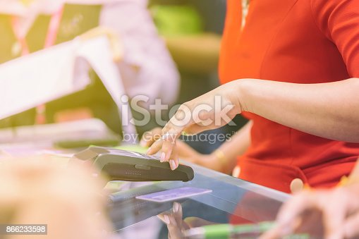 914593772istockphoto Asian Business women hand using credit card swiping machine for payment in cafeteria and supermarket 866233598