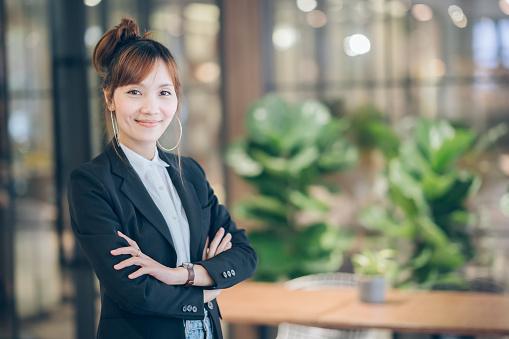 Asian business women standing in modern office working design planning