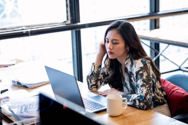 Asian Business Women Stressed About Her Work
