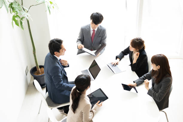 asian businessgroup meeting in office asian businessgroup meeting in office only japanese stock pictures, royalty-free photos & images