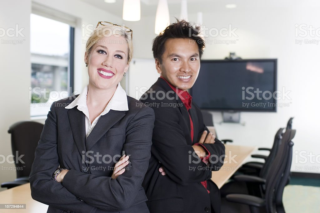 Asian Businessman and Caucasian Woman Business Team, Copy Space stock photo
