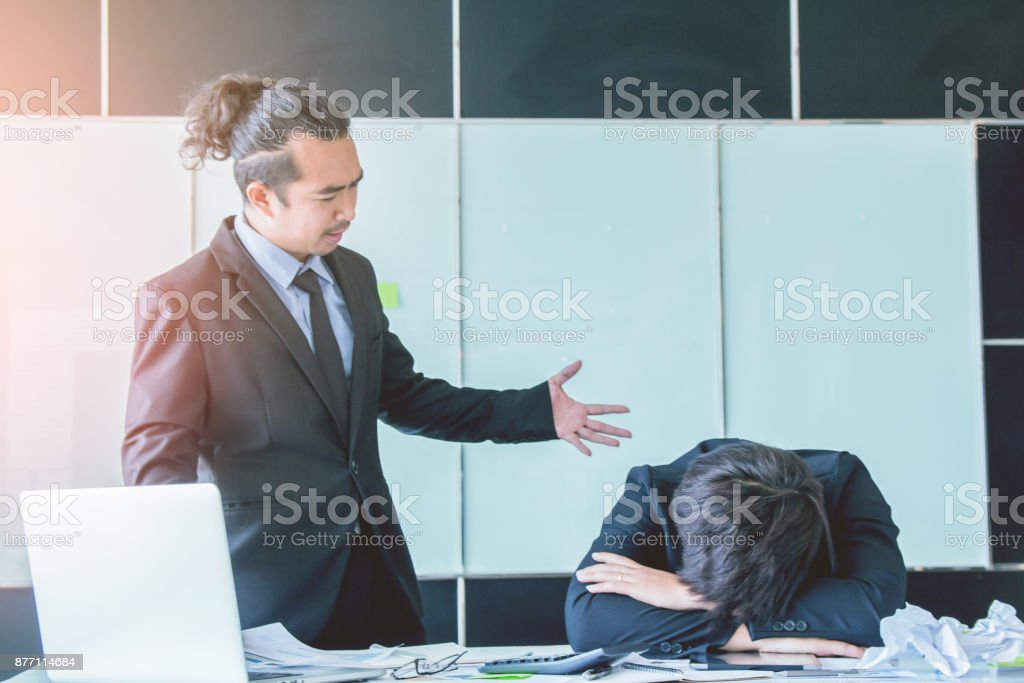 Asian businessman angry  manager  shareholders are unhappy with the running of henchman and  concerned with the way the recent annual meeting  to working team to complaint for project delay ,Unsuccessful  young businessmen hands close of face. stock photo