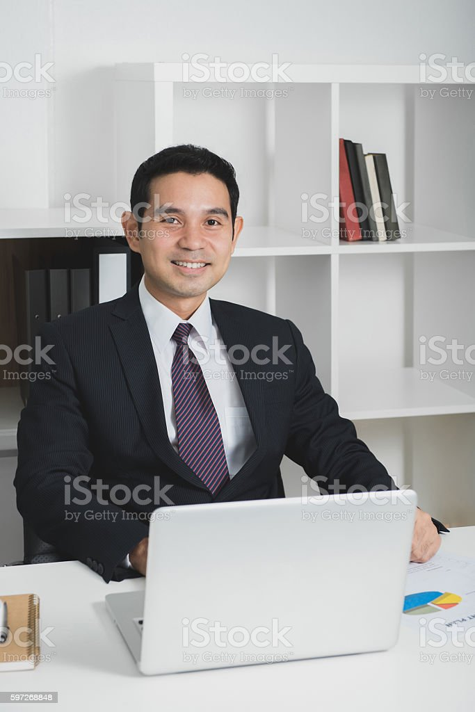 Asian businessman at work with laptop computer on the table royalty-free stock photo