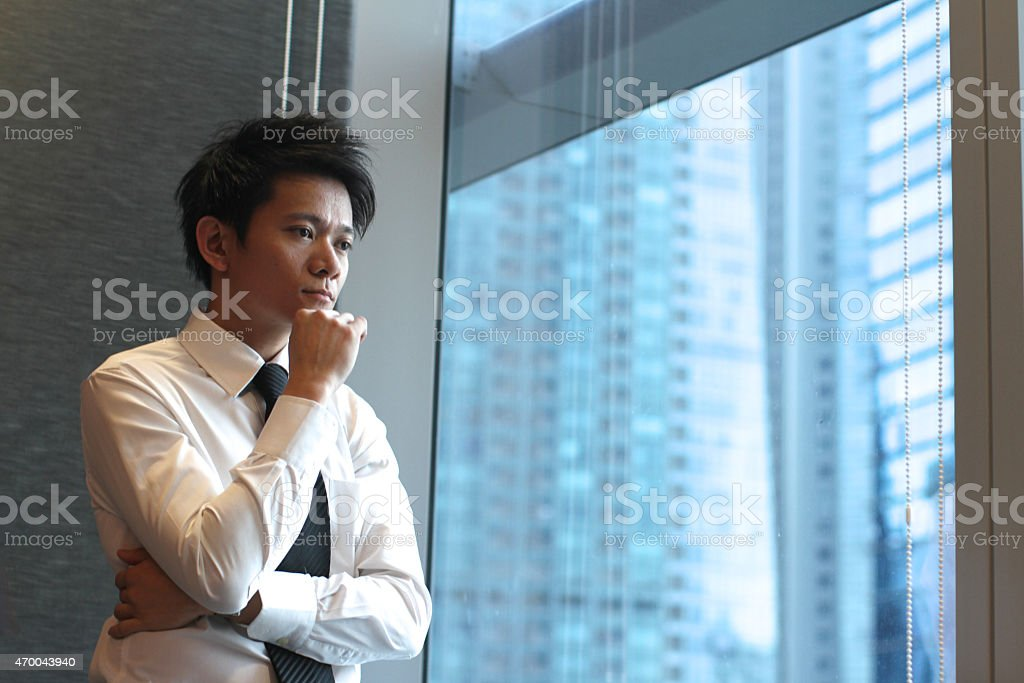 Asian Businessman Deep In Thought stock photo