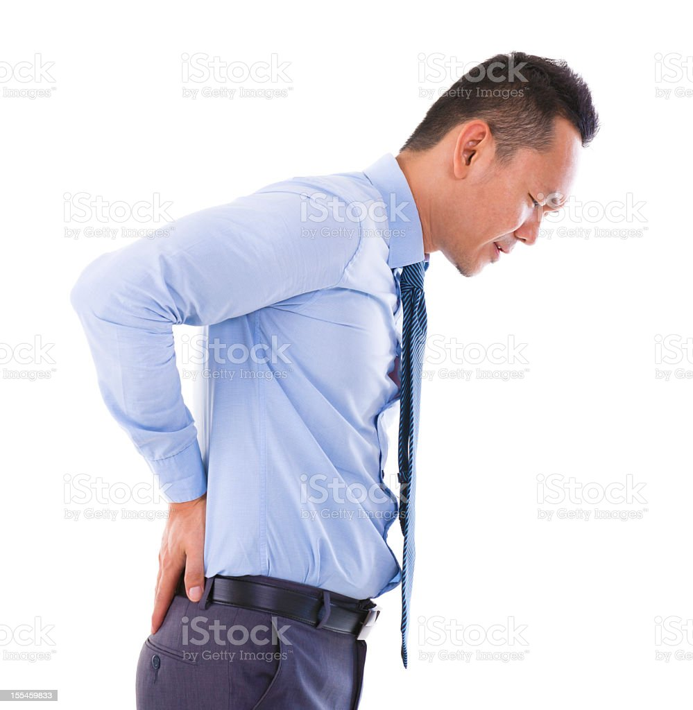 Asian businessman experiencing back pains royalty-free stock photo