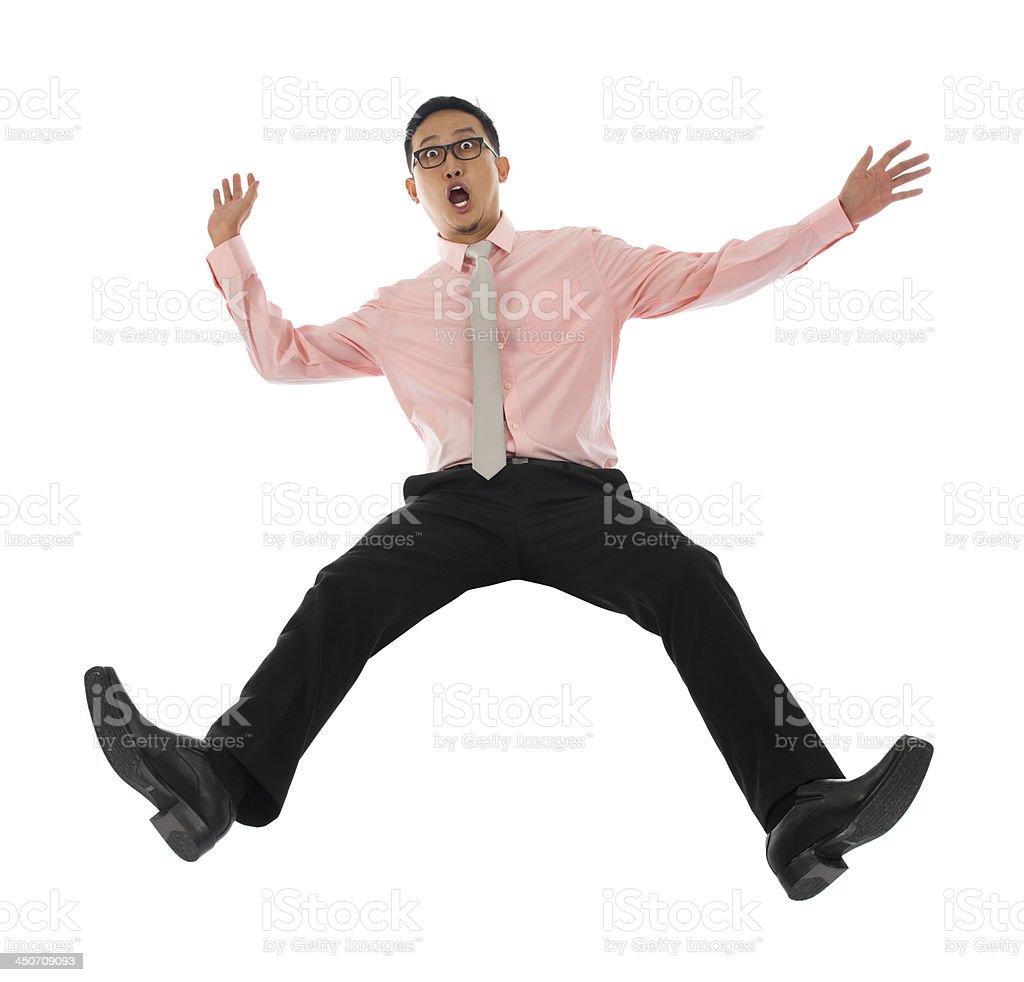 Asian businessman falling backwards stock photo