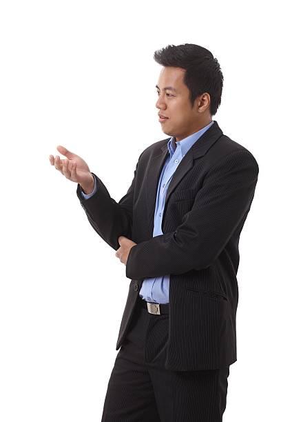 Asian businessman gesturing stock photo