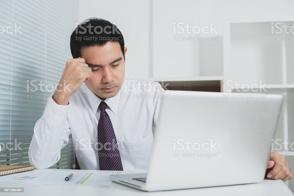 Asian businessman getting stressed at work Lizenzfreies stock-foto