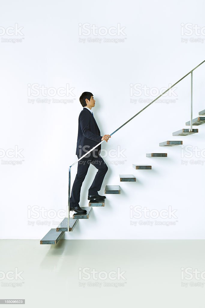 Asian businessman going up royalty-free stock photo