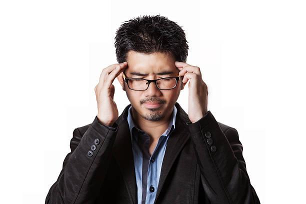 Asian businessman headache and him has strain. – Foto