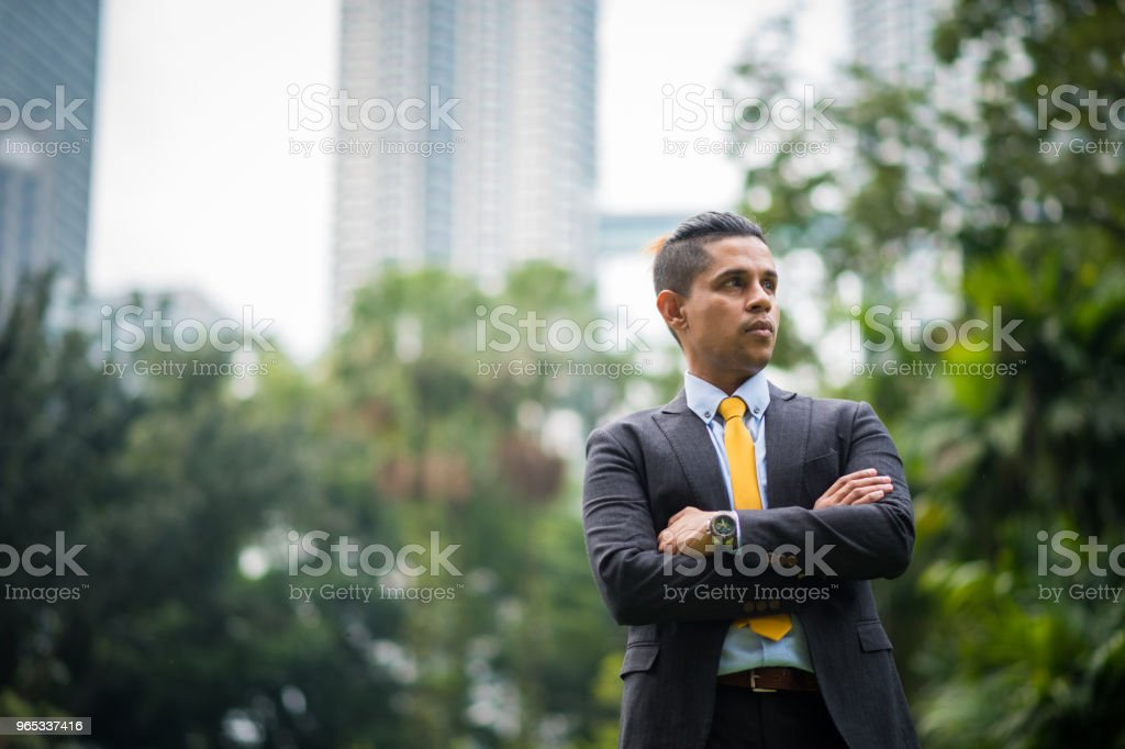 Asian businessman in front of the Petronas Towers royalty-free stock photo