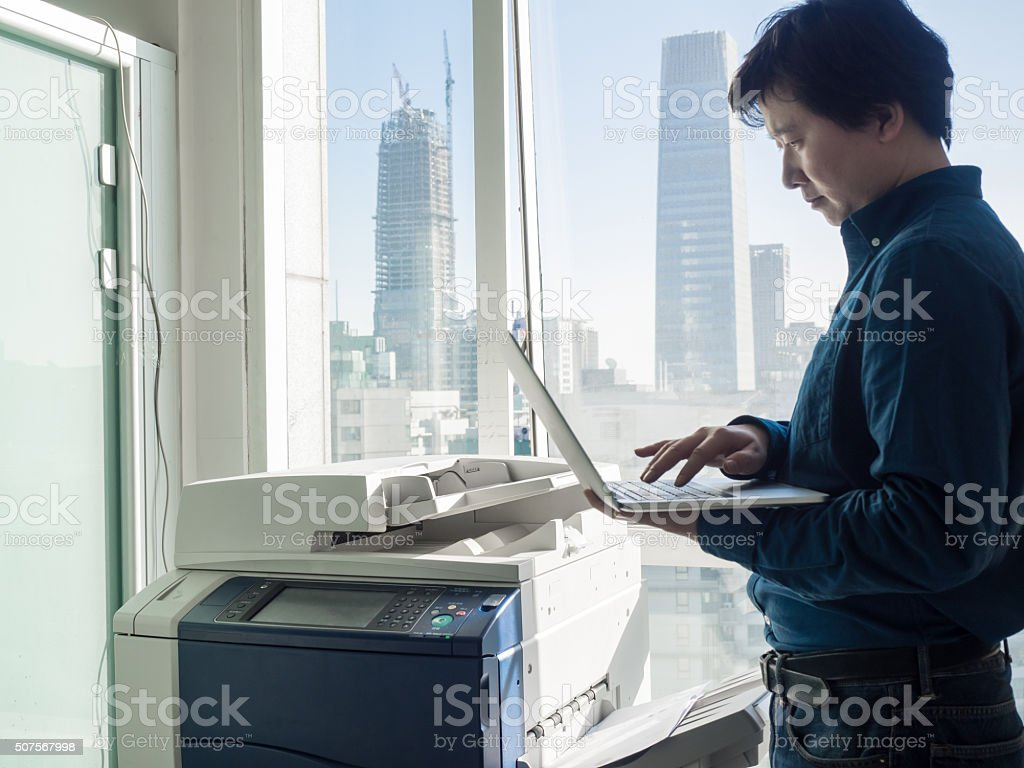 Asian businessman in office stock photo