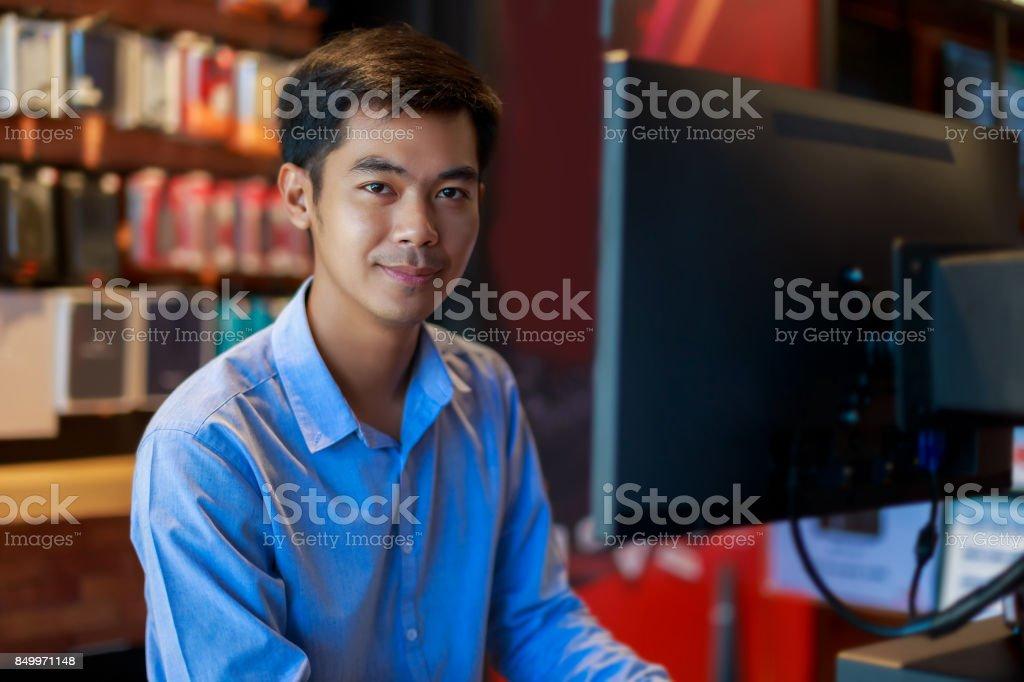 asian businessman looking at camera stock photo