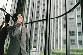 Asian businessman or entrepreneur using mobile phone, business or communication technology concept, with copy space