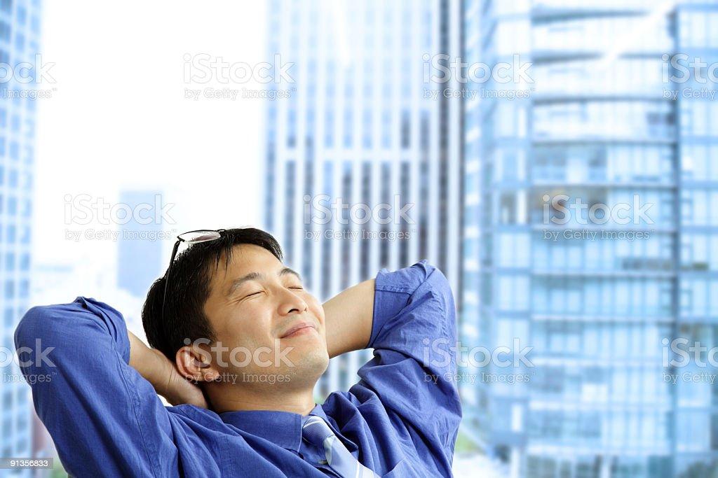 Asian businessman resting royalty-free stock photo