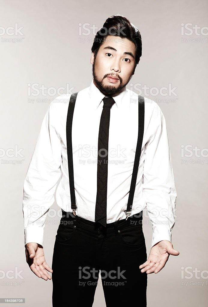 Asian businessman shrugging his shoulders in confusion royalty-free stock photo