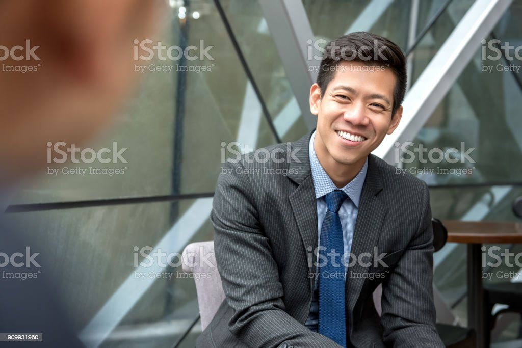 Asian businessman sitting at office lounge stock photo
