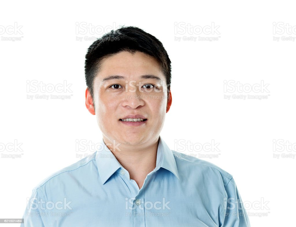 Asian businessman standing against white background photo libre de droits