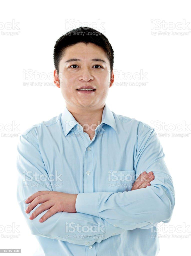 Asian businessman standing against white background photo libre de droits
