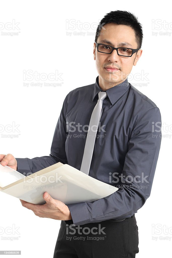 Asian businessman standing and holding a folder royalty-free stock photo
