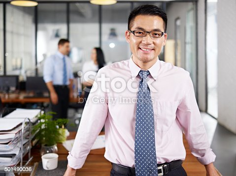 istock asian businessman standing in office 501490036