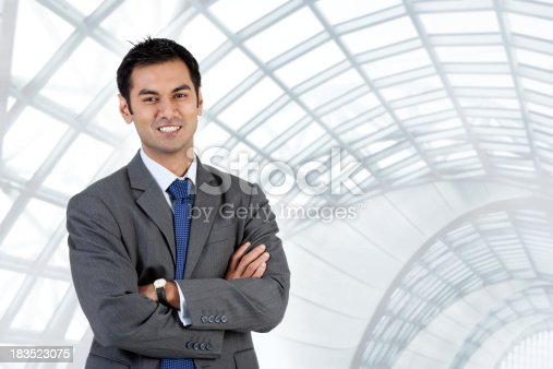 istock Asian Businessman Standing With His Arms Folded 183523075