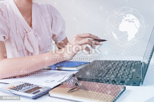 821678930 istock photo Asian Businessman using computer laptop showing trading graph beside the stock exchange trading graph screen laptop,Profit graph of stock market indicator.Business financial and forex concept 828953802