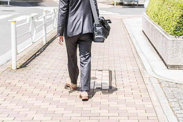 asian businessman walking on the road - 出勤 ストックフォトと画像