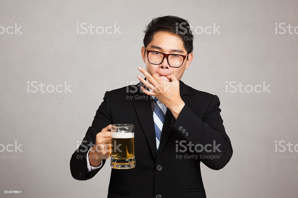 Asian businessman with beer whistle with fingers stock photo