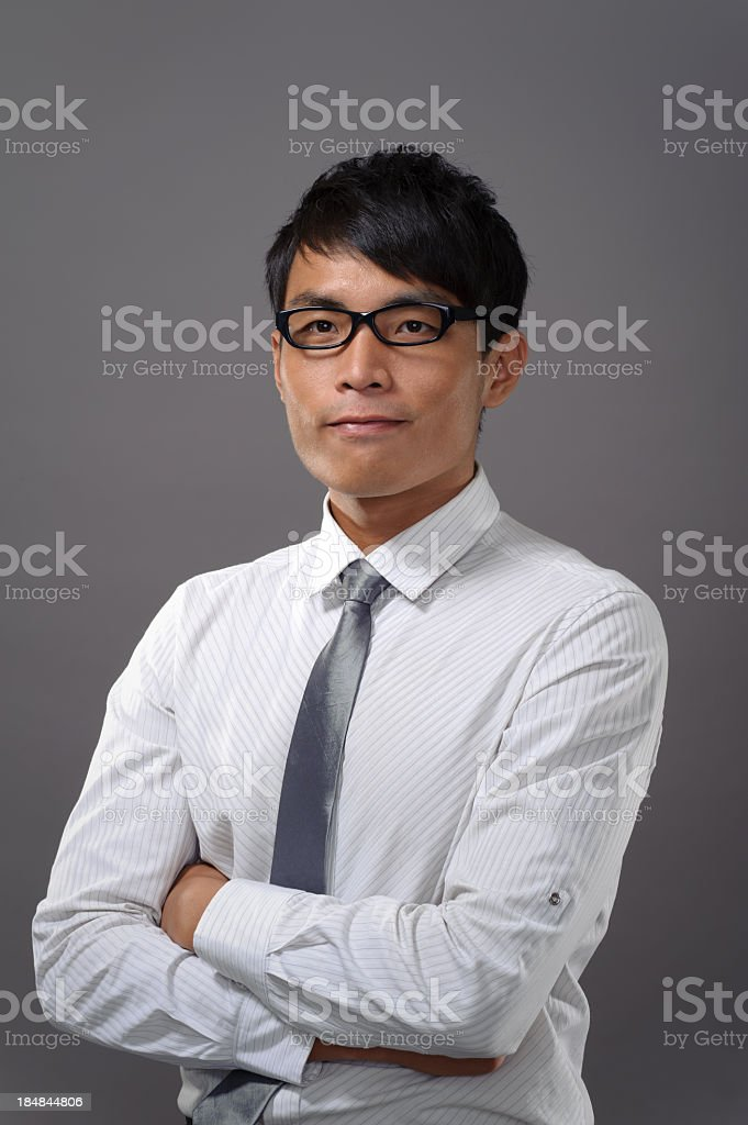 Asian Businessman With Hip Haircut And Black Glasses Stock Photo - Businessman haircut
