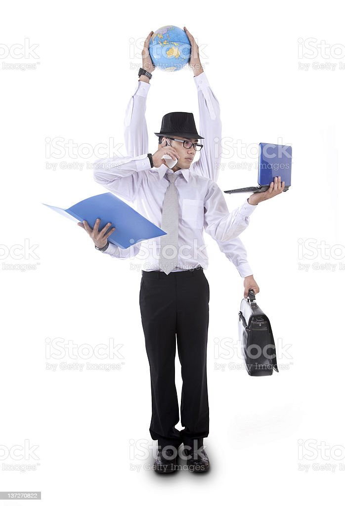 Asian businessman with six arms juggling work stock photo