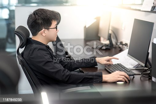 872006502 istock photo Asian businessman working in office 1187845233