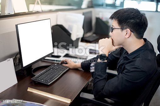 872006502 istock photo Asian businessman working in office 1187859227