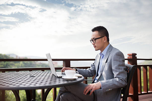 Asian businessman working in the outdoor Coffee Hall stock photo