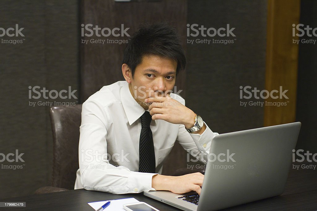 Asian Businessman working on computer, in deep thoughts royalty-free stock photo