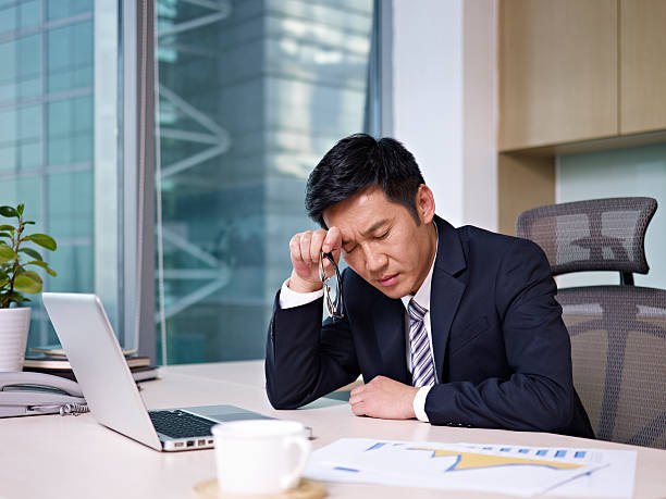 asian businessman working on project - man face down stock pictures, royalty-free photos & images
