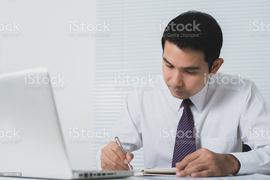 Asian businessman working seriously in the office royalty-free stock photo