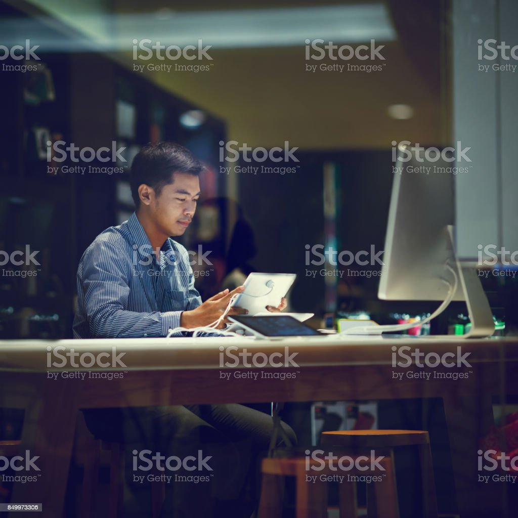 asian businessman working with tablet stock photo