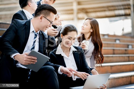 951514270 istock photo Asian businessmen are sitting discussing the job. Many marketing plans from around the world. loading the data. Make decision to invest in stocks. Successful organization will have a good consultant. 1170209309