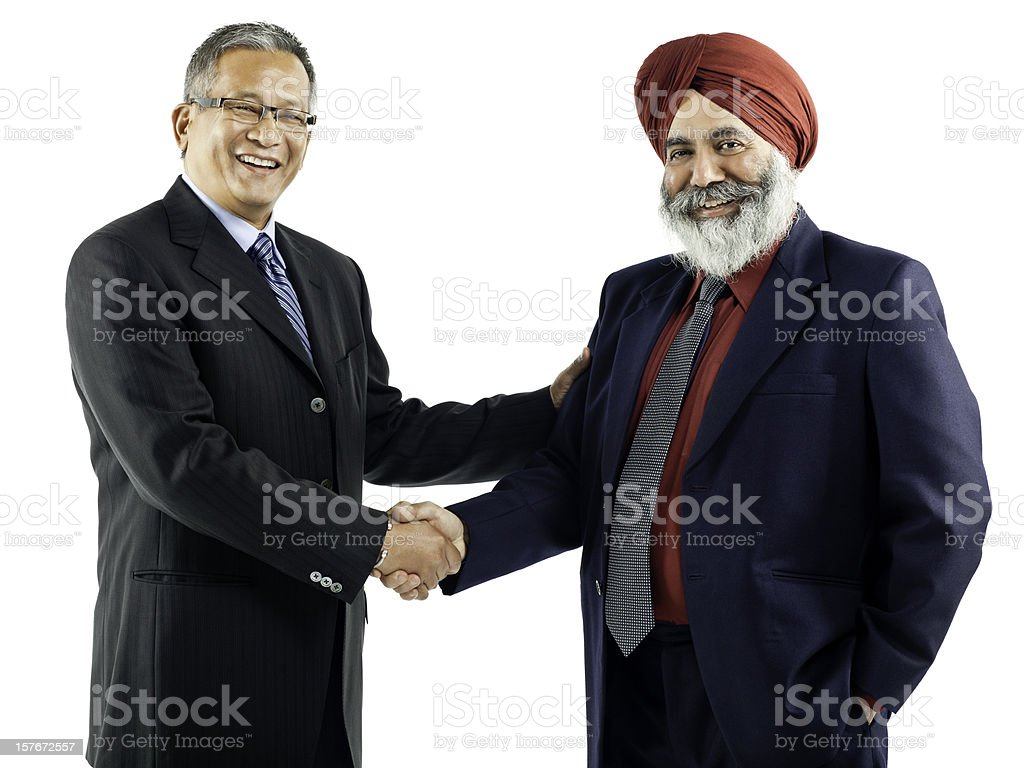 Asian Businessmen Shaking Hands - Isolated stock photo