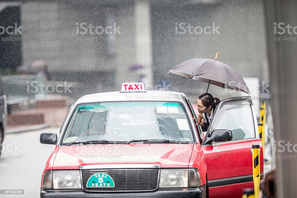 Asian Businesswoman calling a taxi royalty-free stock photo