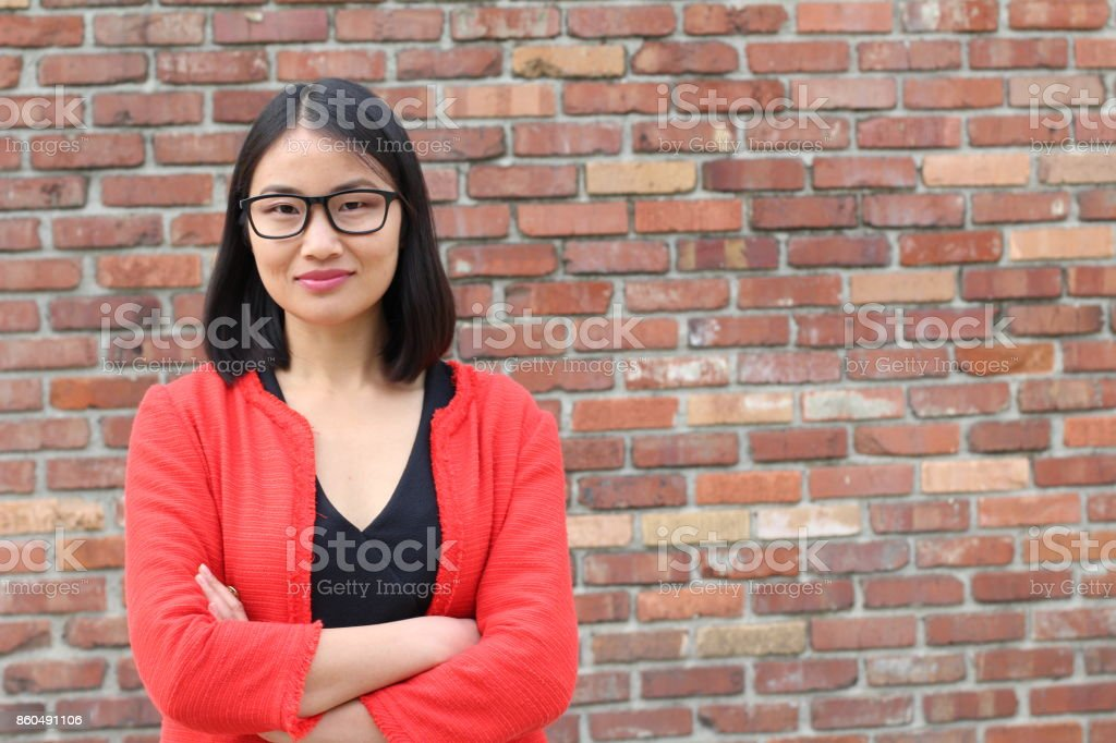 Asian businesswoman crossing her arms stock photo