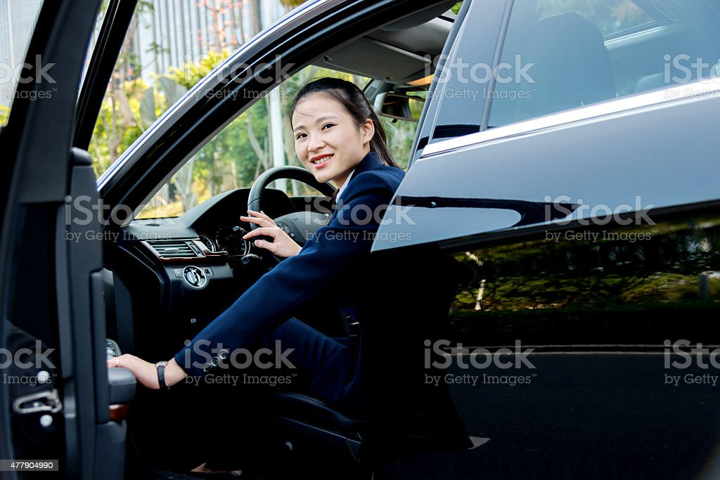 Asian businesswoman driving a car stock photo