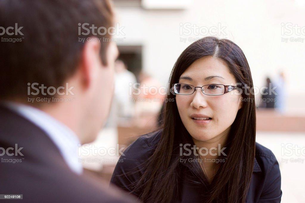 Asian businesswoman in conversation stock photo