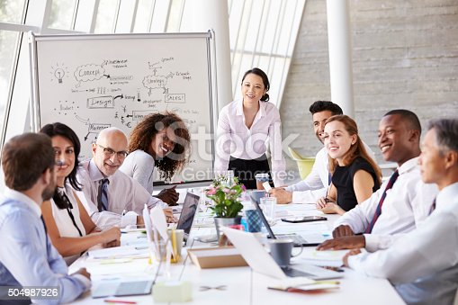 504987926 istock photo Asian Businesswoman Leading Meeting At Boardroom Table 504987926