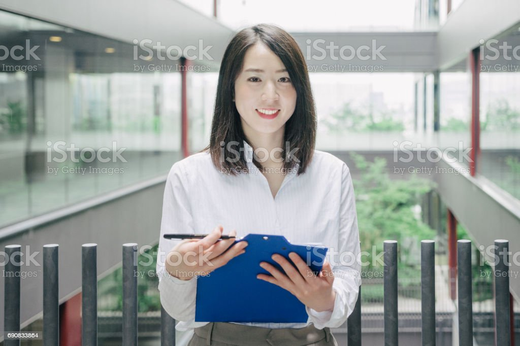 Asian businesswoman looking at camera stock photo