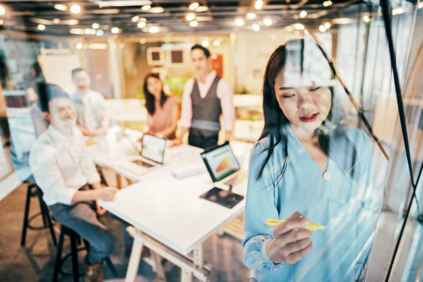 Asian Businesswoman presenting her ideas for company development stock photo