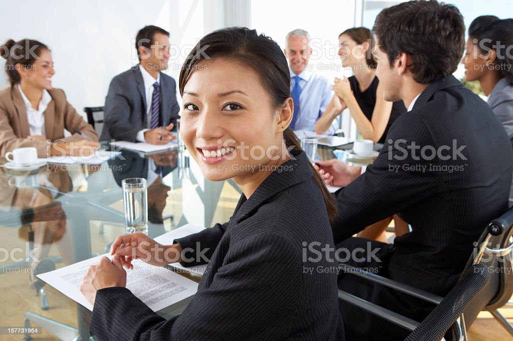 Asian Businesswoman Sitting Around Boardroom Table royalty-free stock photo
